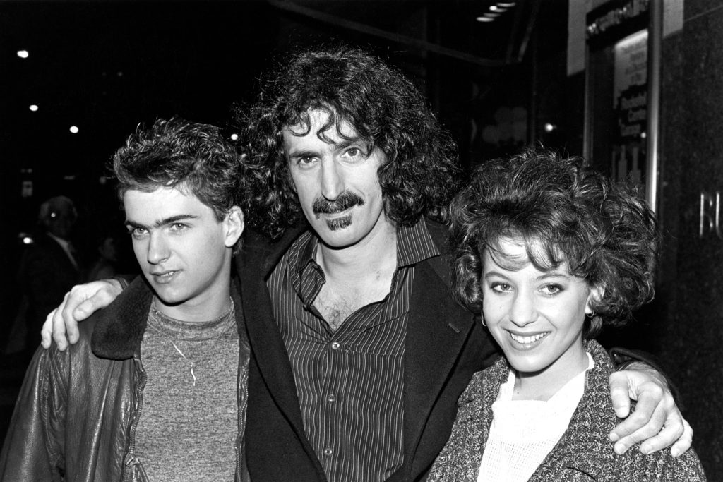 Frank Zappa with his children Dweezil and Moon in New York in 1982. Dweezil, today a noted guitarist, has had to change the name of his project from Zappa Plays Zappa to Dweezil Zappa Plays Frank Zappa for copyright reasons. Credit [Geoffrey Croft/Retna]